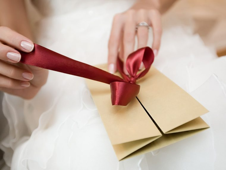 Bride opening a post card