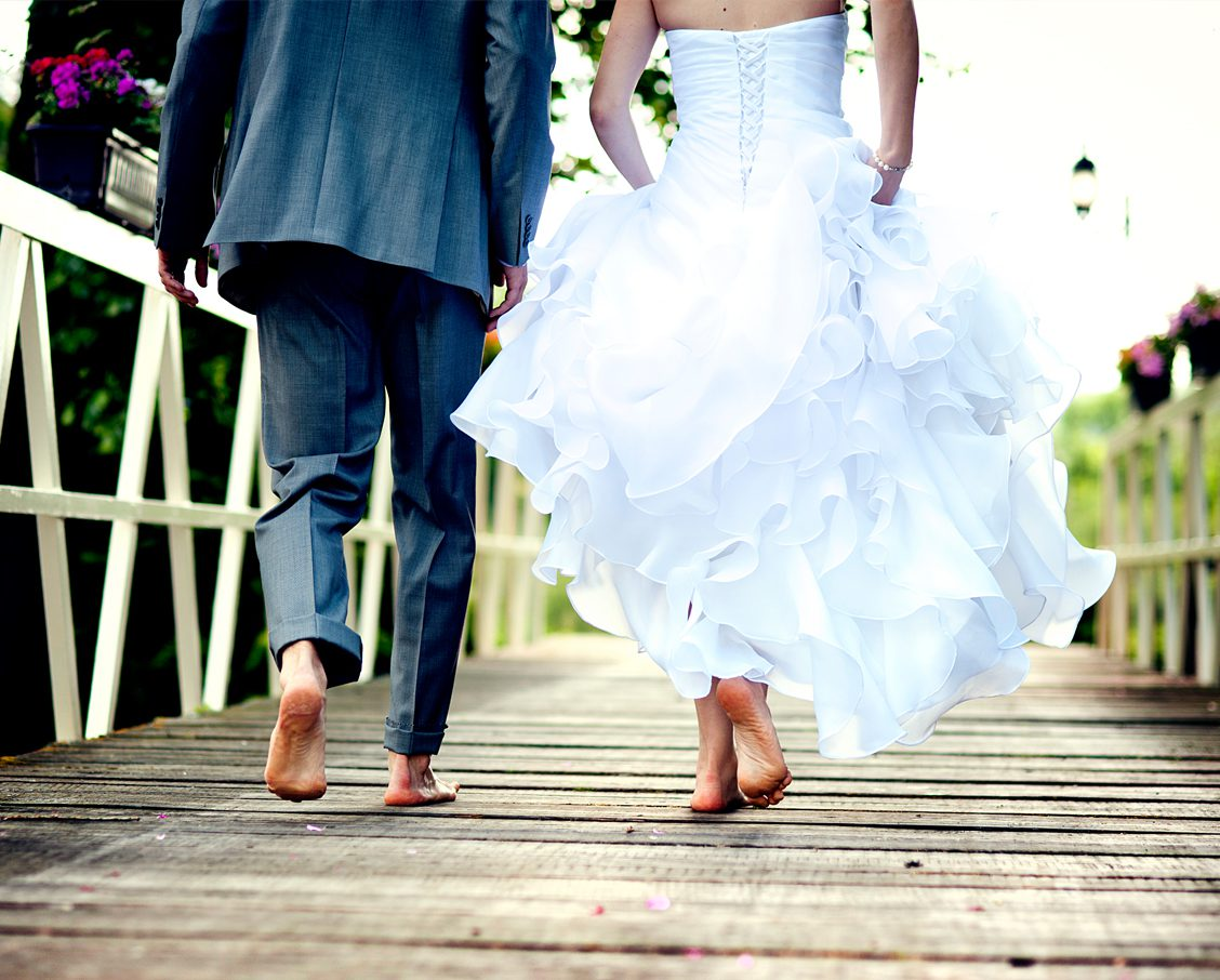 Bride & Groom walking barefoot