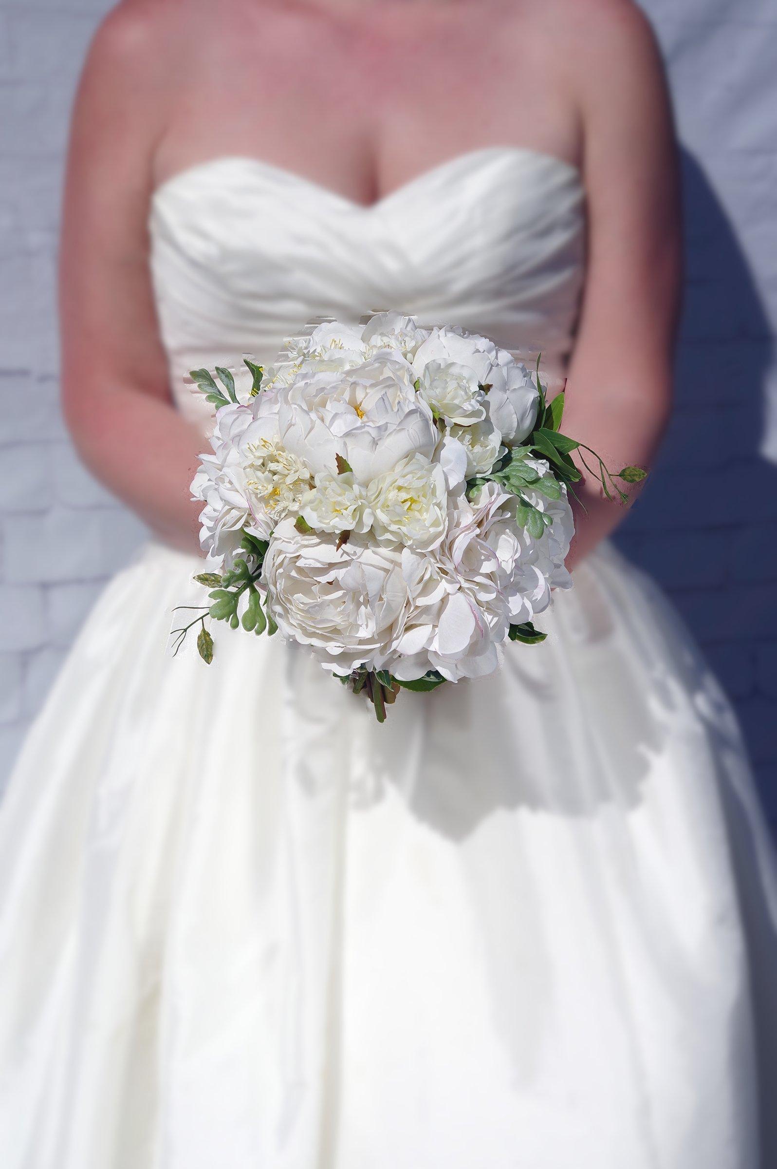 Bride Holding A Flower Bouquet